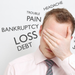 depressed man in debt because took too many payday loans